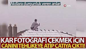 Kar fotoğrafı çekmek için canını tehlikeye atıp çatıya çıktı