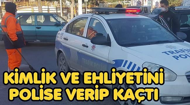 KİMLİK VE EHLİYETİNİ POLİSE VERİP KAÇTI
